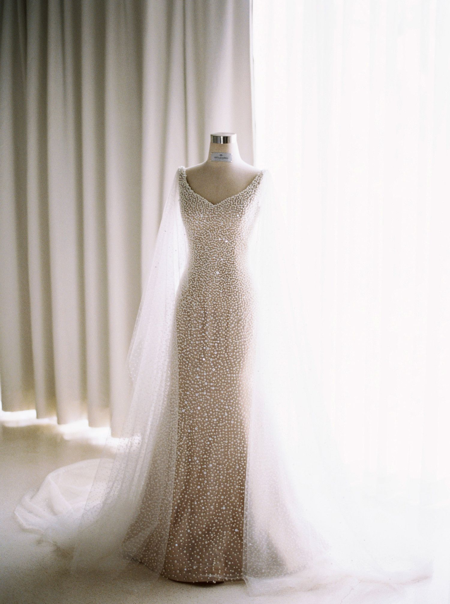 Design your own wedding dress near me  This one featuring a formfitting silhouette slight Vneck and