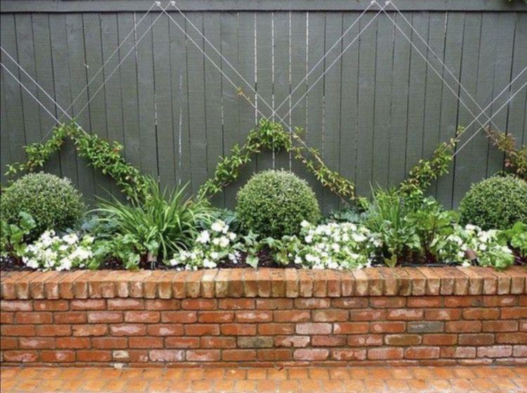 Use Command Hooks On The Fence Plus Rope Wire To Do Diy Garden Trellis Brick Garden Brick Planter