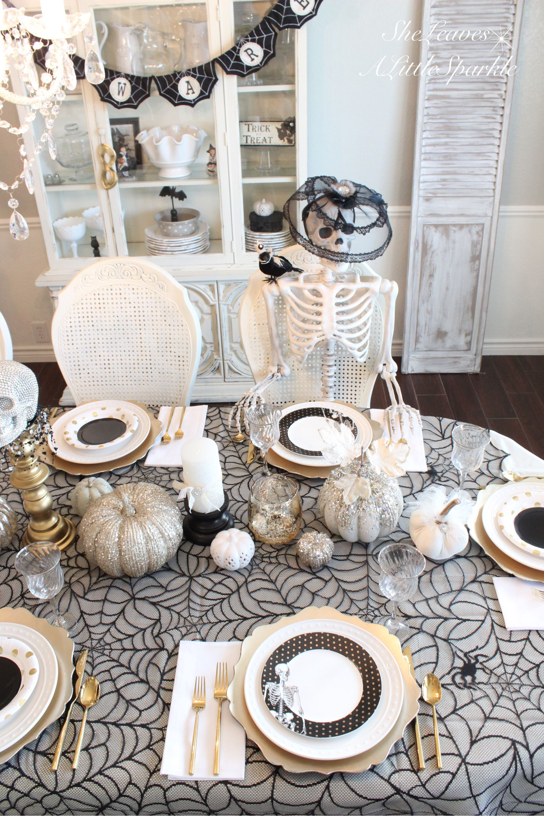 spooky glam halloween table sheleavesalittlesparkle black white gold chic elegant classy halloween decor dining table tablescape