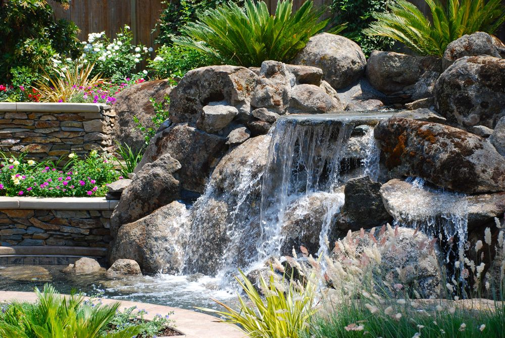 Rock waterfalls for landscaping natural rock water for Waterfall garden feature