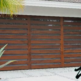 This Is A Cool Garage Door It S Reminiscent Of Pallets Think Reclaimed Lumber But Modern And Fresh