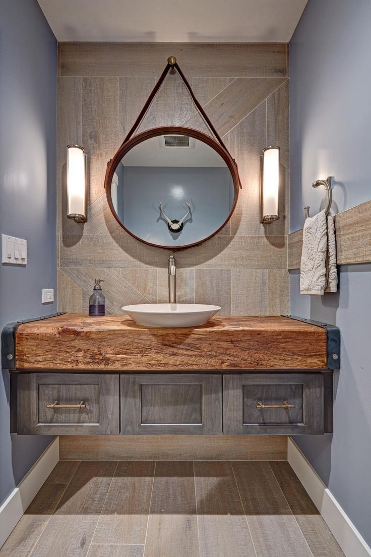 This bathroom features both earthy and industrial elements, and ...