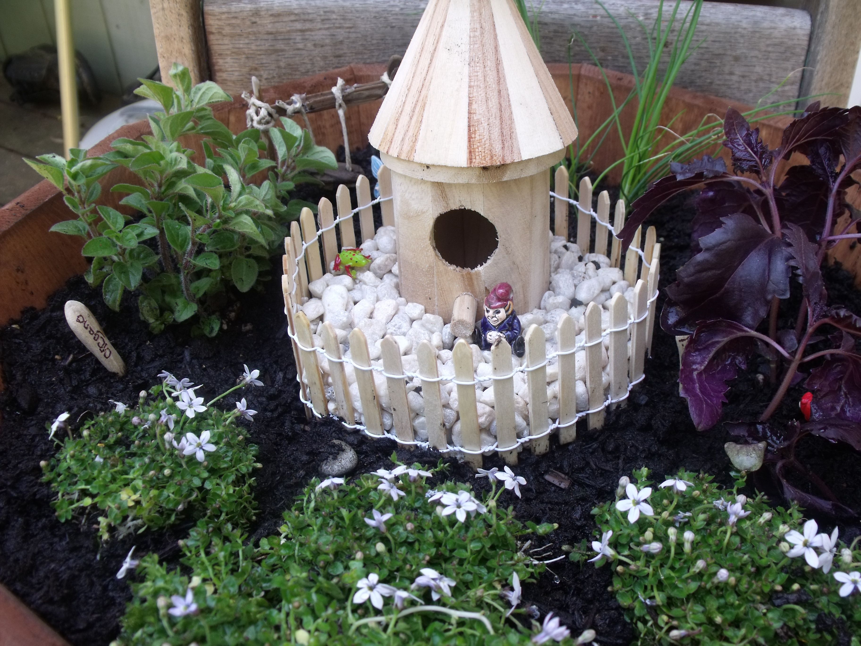 the fairy garden i made for my mom. Outdoor decor, Decor