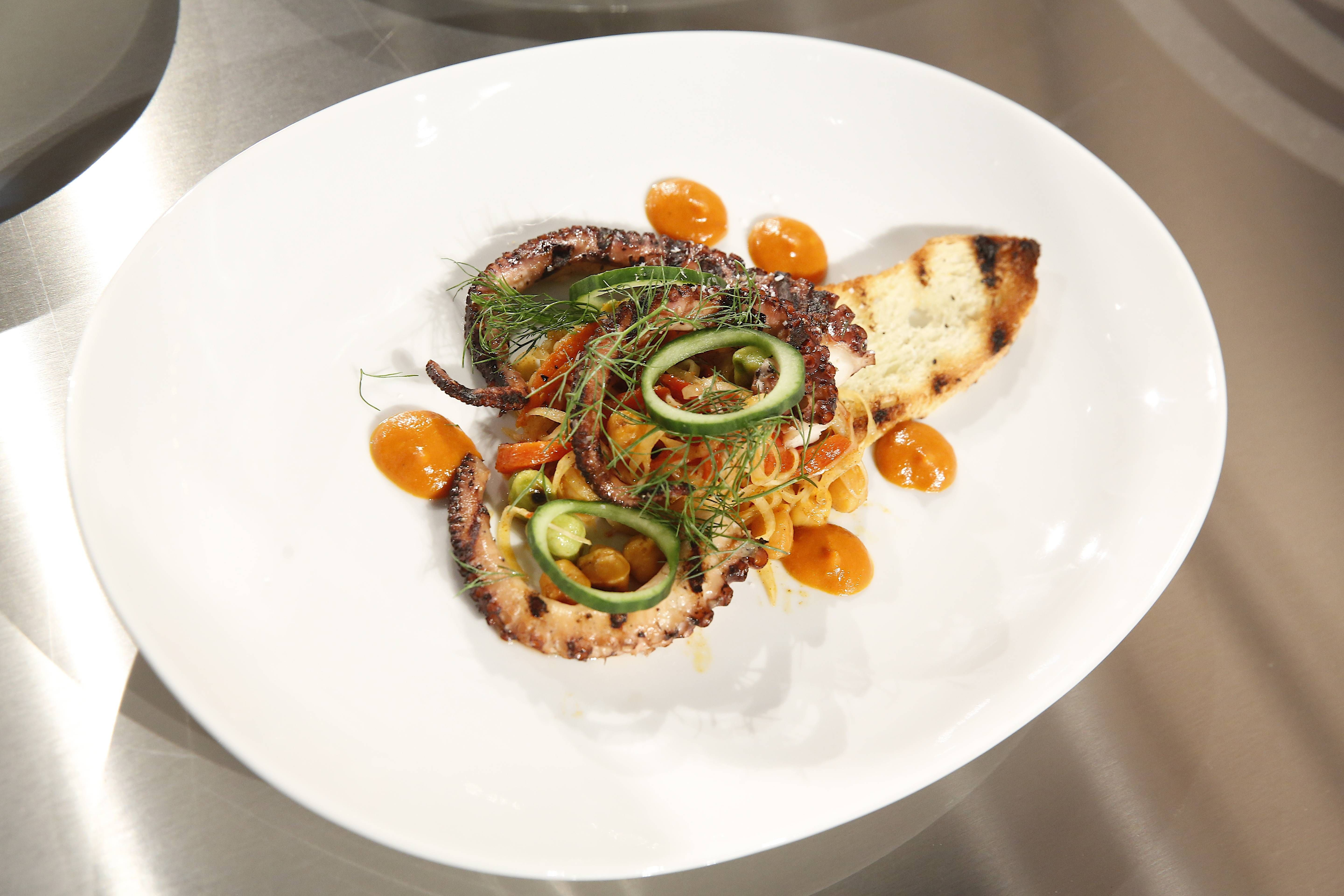 Elizabeth S Appetizer Grilled Octopus With A Warm Chickpea And Chorizo Salad Served Beside A