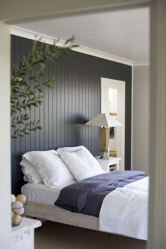 The Dark Painted Wood Paneling Feature Wall Makes Quite A Statement In This Simple Yet Sophisticated Bedroo Feature Wall Bedroom Paneling Makeover Home Bedroom