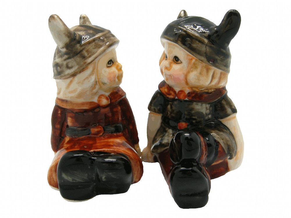 This charming ceramic salt and pepper shaker set will add a welcome accent to your kitchen or pepper and salt set collection. This set features a charming Viking boy and girl pair. - Approximate Dimen