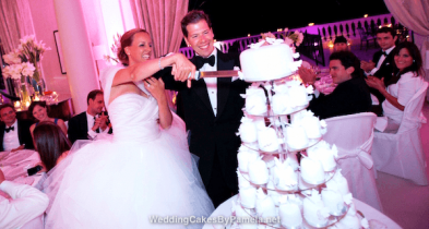 The happy couple with their beautiful tower of individually iced and decorated Wedding Cakes. Made up of mini lemon drizzle cakes, they tasted as good as they looked. Yum! Pamela designs and makes Wedding Cakes for destination weddings in the French Riviera, Provence, Var and Alpes Maritime. Delivering throughout the region from Monaco, Nice, Cannes, to Saint Tropez & Aix en Provence and everywhere in between.