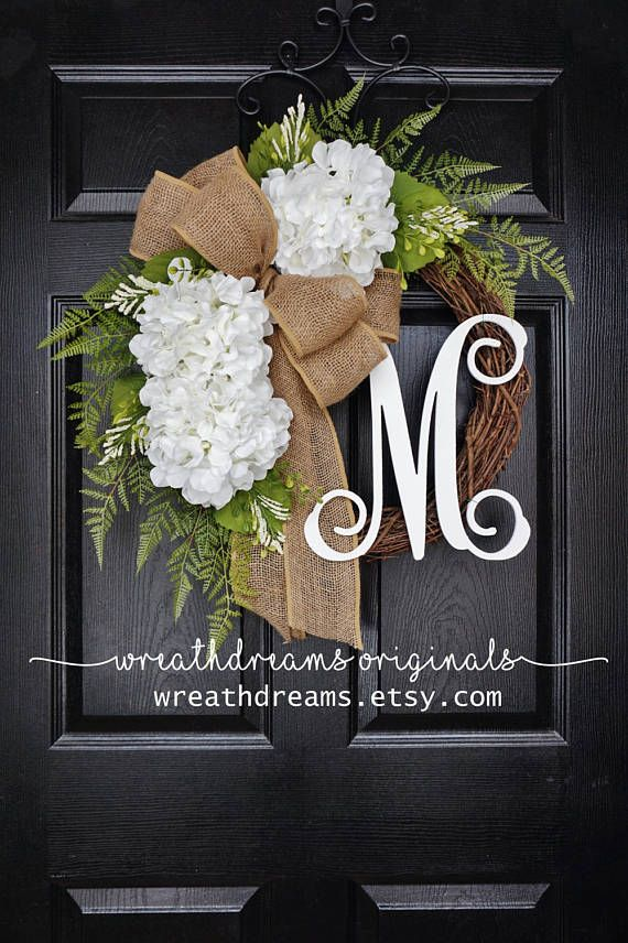 Grace your front door this this beautiful monogram grapevine wreath decorated with a lush Hydrangea blooms & greenery complemented by a burlap ribbon  ***Wreath shown is a 20-inch wreath with a 14-inch Script monogram.  ❤ All wreaths are handcrafted by me using natural grapevine wreaths & only the highest quality faux materials.  ❤ Wreath Specifications: • Choose from 18, 20, 24 or 26. • Please note that grapevine wreaths are natural products so measurements & shapes may vary slig...
