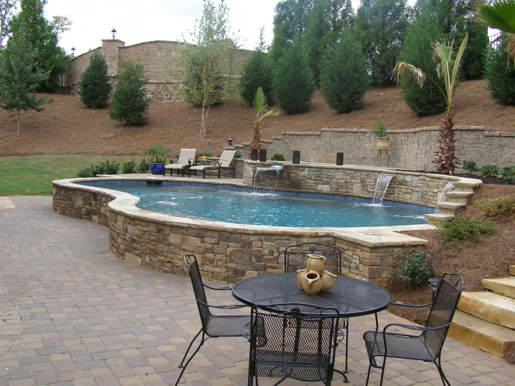 Raised pool with waterfalls pool ideas pinterest for Pool design sloped yard