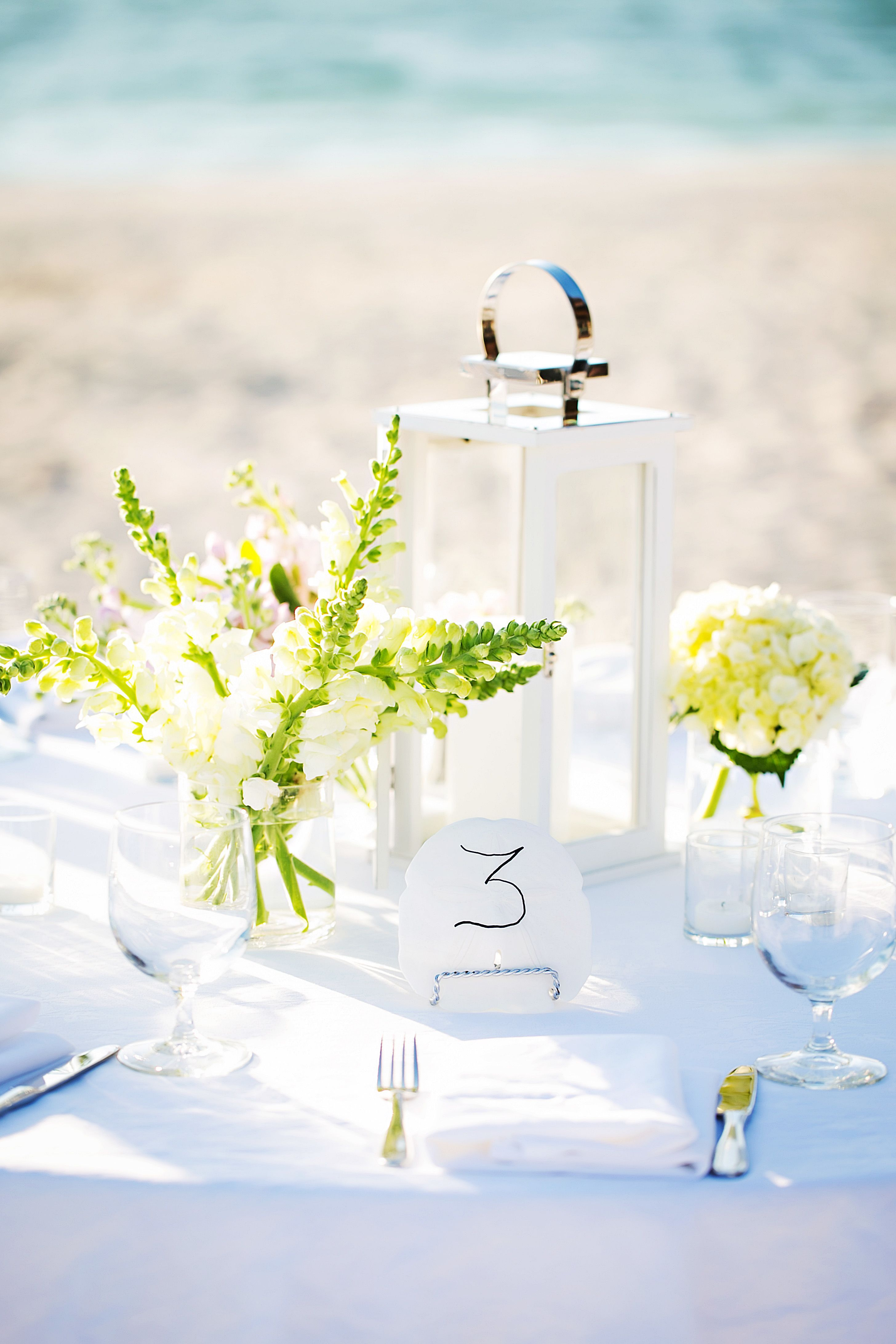 Simple White Lantern and Floral Outdoor Centerpieces | Weddings ...