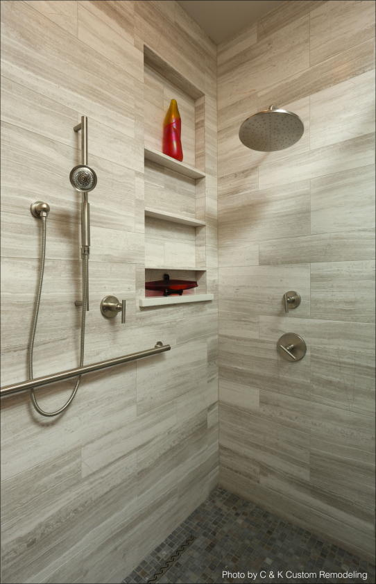 Photo of Remodeled bathroom with built-in shelves a rainfall shower head brushed nickel f…