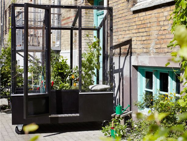 Stylish Urban Greenhouse On Wheels Urban Gardens Urban Garden Greenhouse Build A Greenhouse