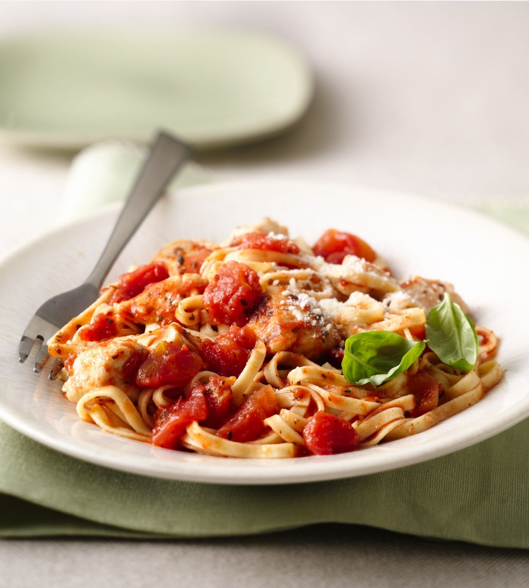 Looking for a one-dish dinner? Enjoy this Italian-inspired masterpiece in a short 20 minutes. Made with just six ingredients, including staple ingredients like boneless, skinless chicken breasts, Parmesan and canned tomatoes, this supper is sure to satisfy.