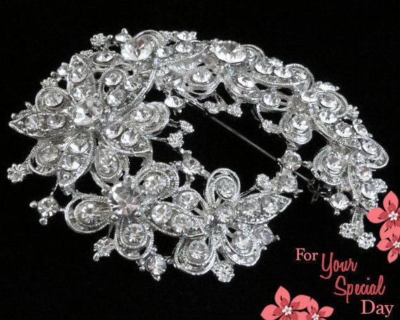 Such a stunning rhinestone crystal brooch comb with a beautiful floral pattern! Shines and sparkles at every angle and will put a smile on your face. Made of grade A+ crystal rhinestones that catch the light at every angle. This brooch comb happens to be one of my favorites. $37.99