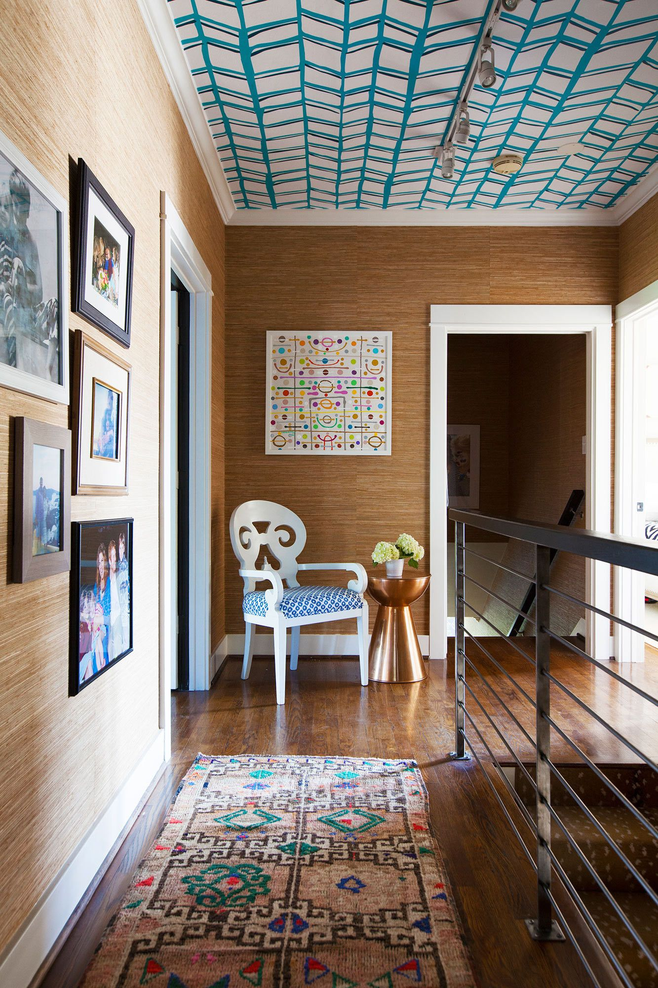 katie kime s colorful house in austin is everything blue wallpapered ceiling grasscloth walls and indie runner
