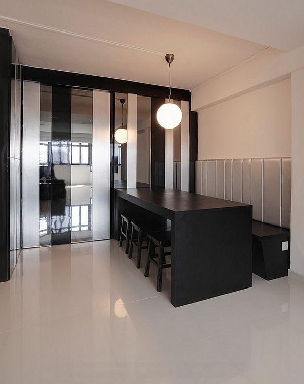 Sleek Dining Space In Minimalist Design Equipped With A Long Table Three Stools Bench And Pendant Lamp
