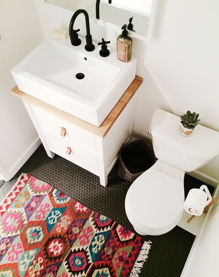 Clean bright bathroom tile white wood counter vanity rug colorful