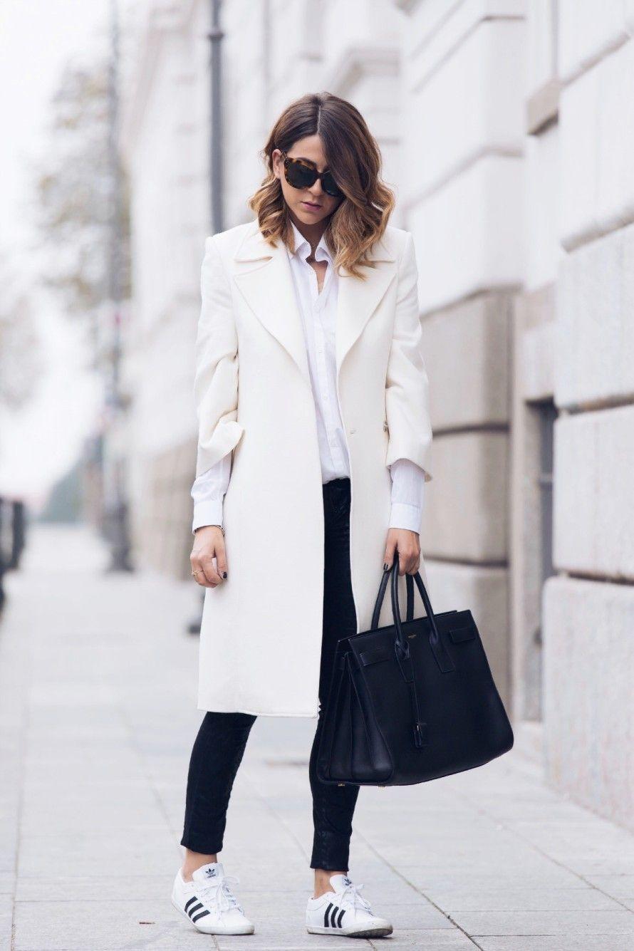7a64362dc7 Street Style January 2015  Nicoletta Reggio is wearing a white coat from  Flavio Castellani