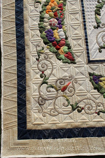 Straight-line or geometric quilting is a good contrast with curvy rounded applique.  Flourish on the Vine - designed by Kathy Wylie, pieced and appliqued by Loanne and quilted by Judi Madsen of Green Fairy Quilts.: