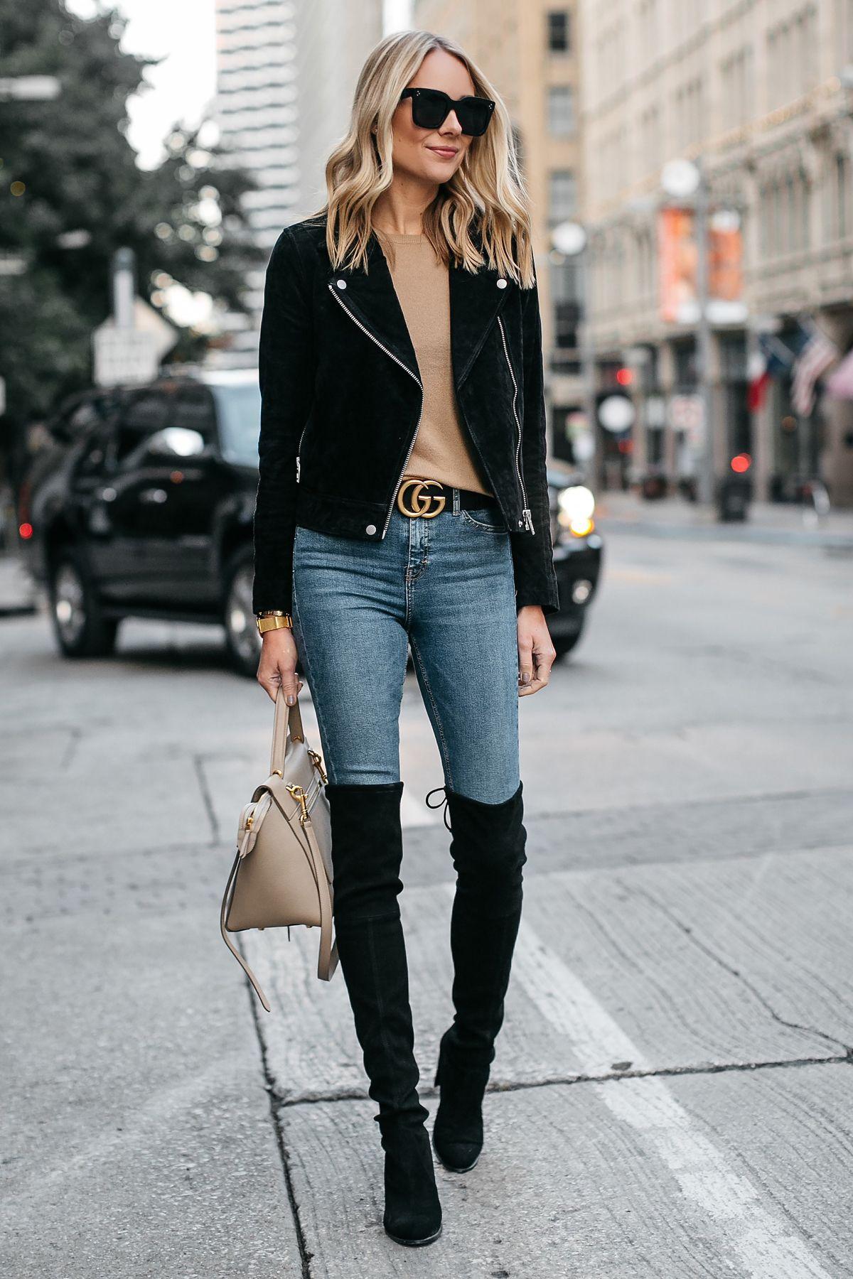 3f3753aa1ee Blonde Woman Wearing Black Suede Moto Jacket Camel Sweater Denim Skinny  Jeans Stuart Weitzman Over-the-Knee boots Gucci Marmont Belt Fashion  Jackson Dallas ...