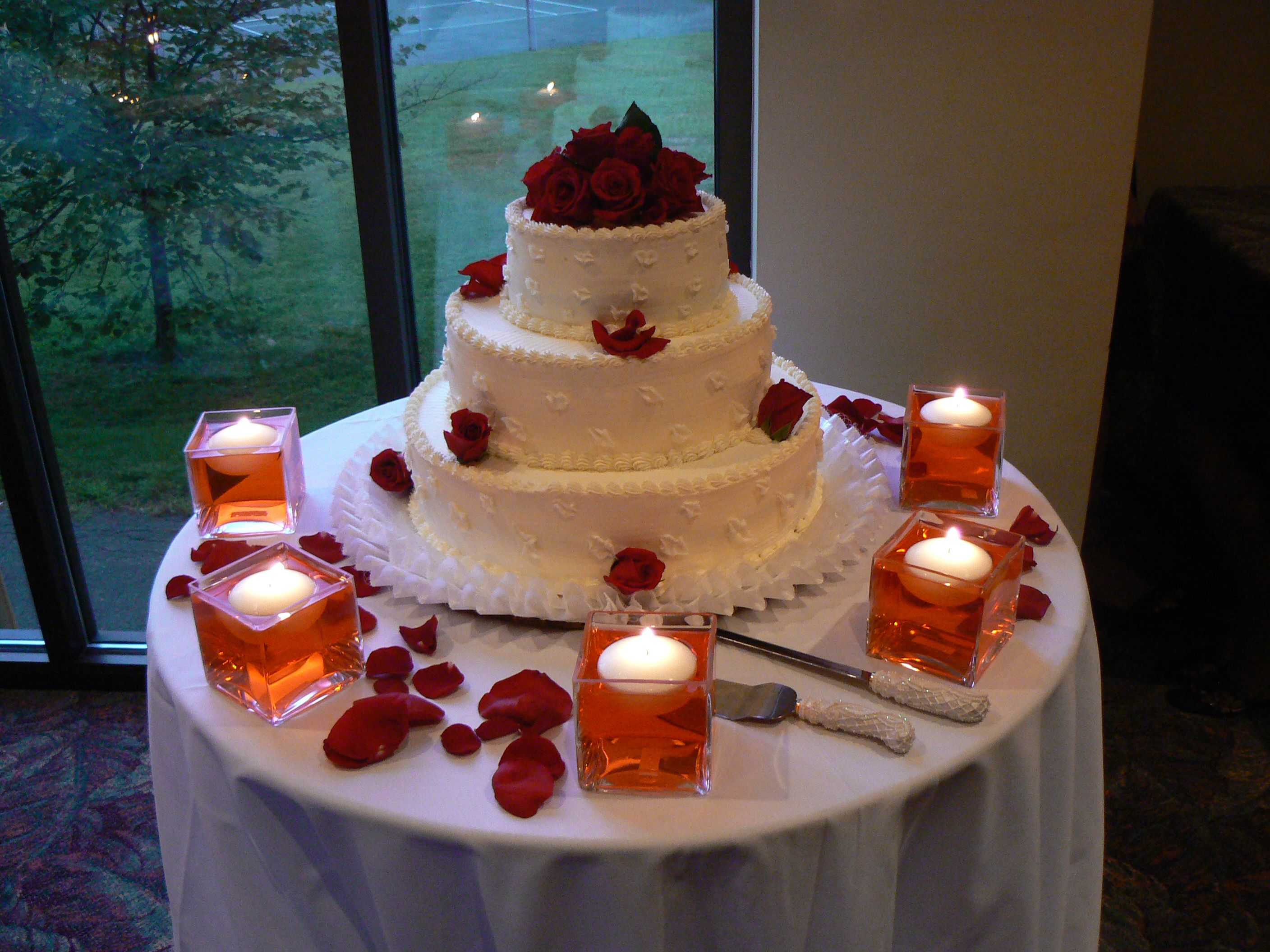 Wedding decorations on cars  surrounded by floating candles in colored water  Wedding Cakes