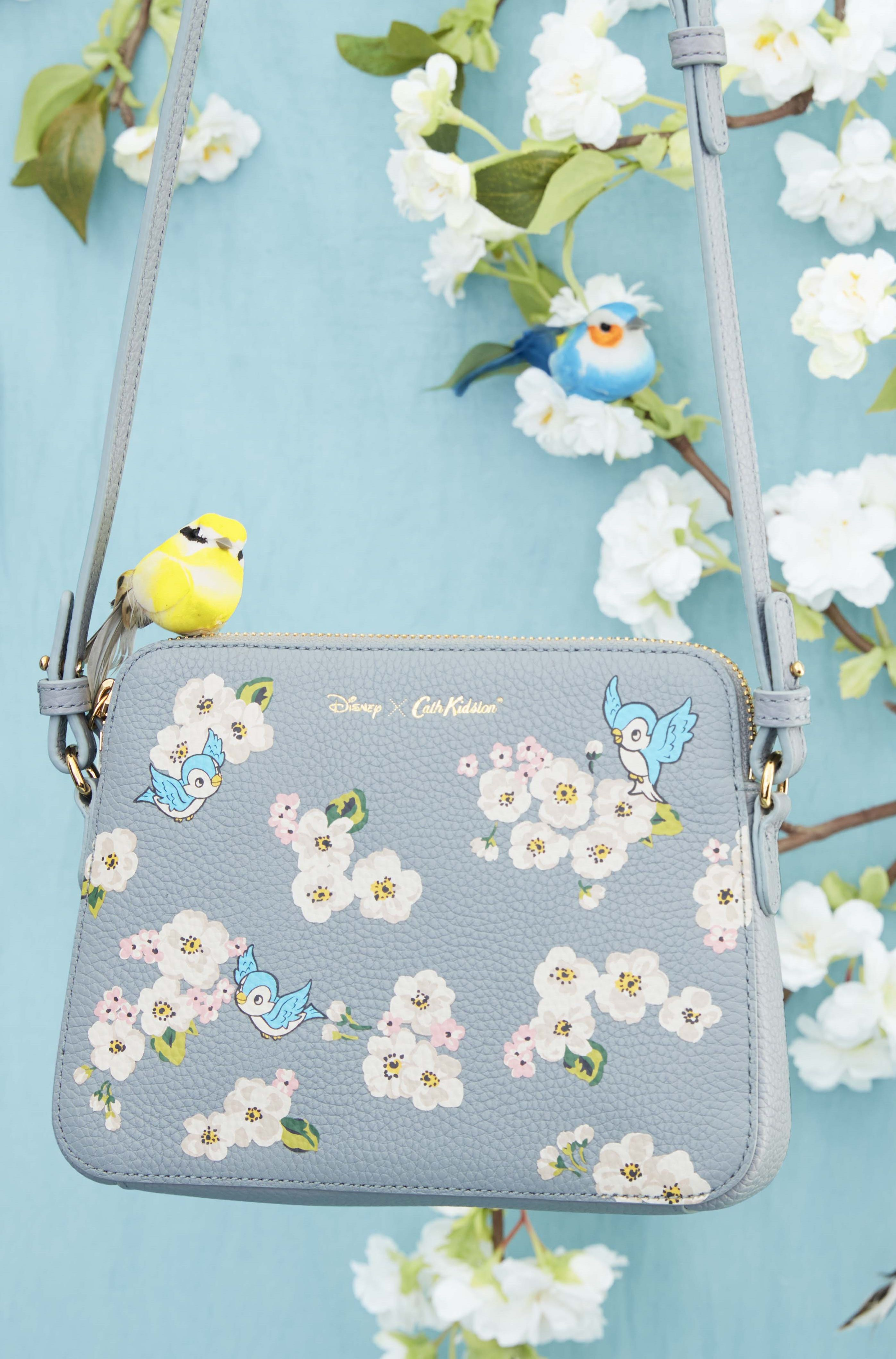 e239ea318f03 ... cross body handbag with birds and floral print on. Features luxury  leather with over the body long strap. Limited edition print. Disney X Cath  Kidston ...