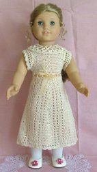 Use this free crochet pattern to make a beautiful crochet dress for your daughter's American girl doll. It's a delicate-looking dress she'll love dressing her doll up in.