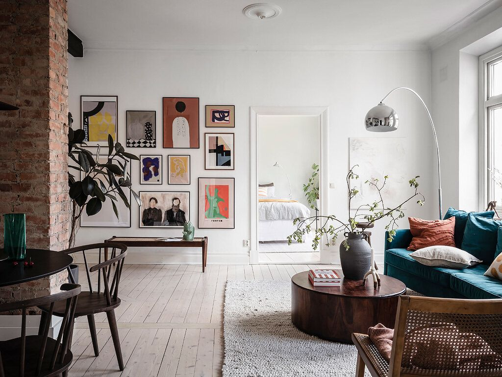 A Scandinavian Apartment With Exposed Brick Wall And Colorful Touches The Nordroom In 2020 Scandinavian Apartment Home Decor Living Room Paint