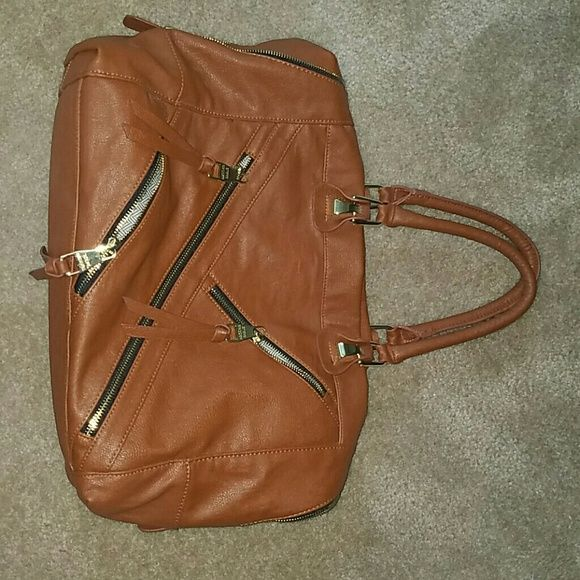 Steve Madden purse... zipper details very cute Extended strap included with bag.... worn once. Lots of space inside.  outer zippers are useable to store small items Steve Madden Bags Hobos