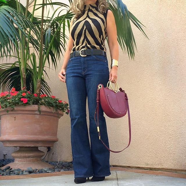 How to wear flare jeans is my newest blog post. #styletip 👉 when buying flare jeans length is one of the most important considerations. Know what heel height you plan to wear with the jeans. Unlike skinny jeans that look good with any heel height, a specific length of flare jeans will only look best with one heel height. #fashiontips #flarejeans . . . . #styletips #fashiontip #outfitinspo #igstyle #animalprint #styleupdates #casualchic #instastyle #outfits #instafashion #40plusstyle #everyda