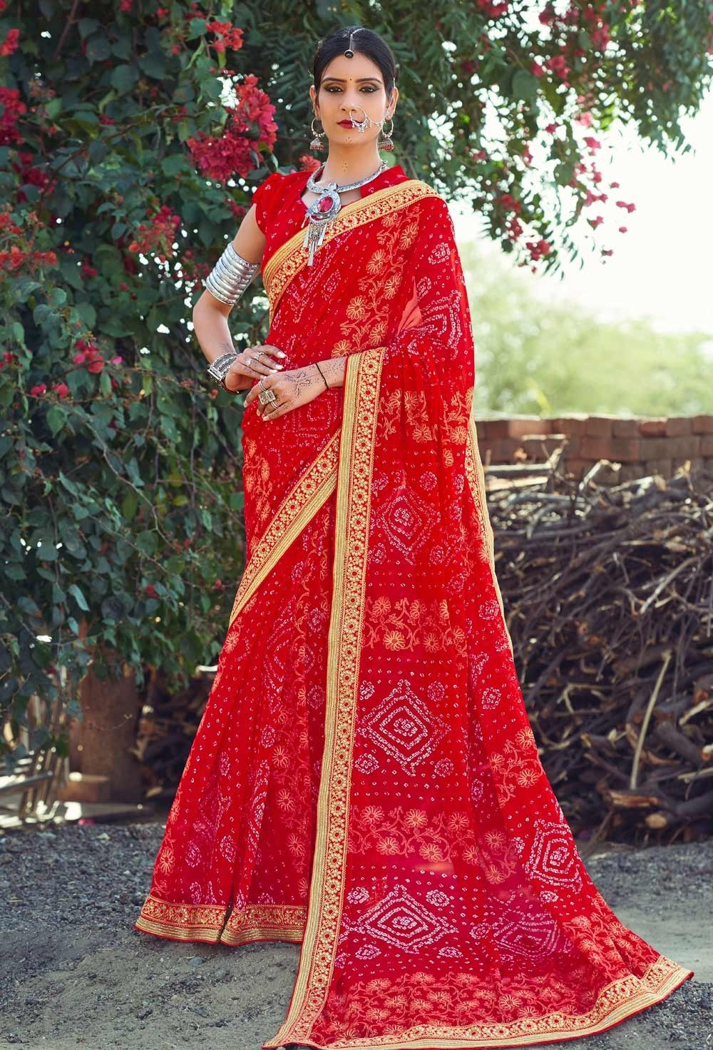 b5ba2e5309 Festival wear red Georgette Bandhani Saree With Stone Work lace border