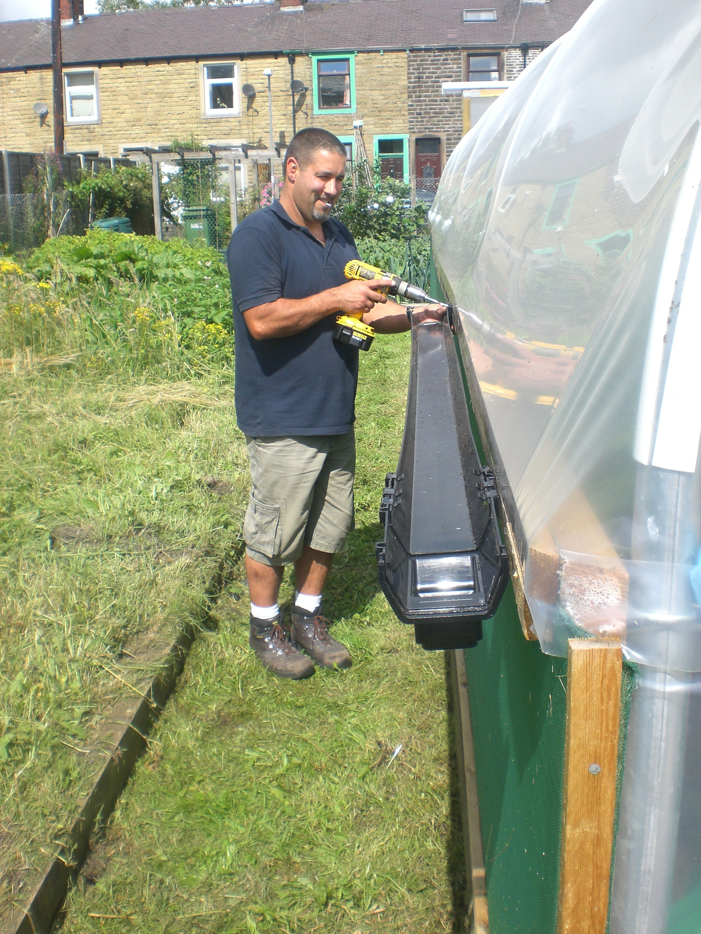 Collecting rainwater from a Polytunnel using guttering