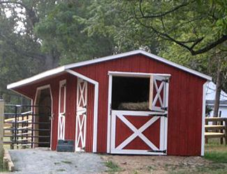 Run in stall doubles as grooming stall and hay grain for Horse barn prices and plans