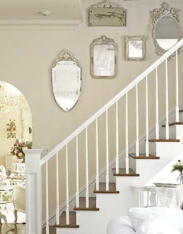 Painted mirror collection up the stairs