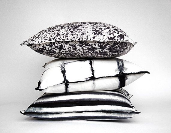 set of 3 one of a kind, hand dyed Shibori pillows by Pink Bomb, in black and white stripes, grid and paint splatter patterns