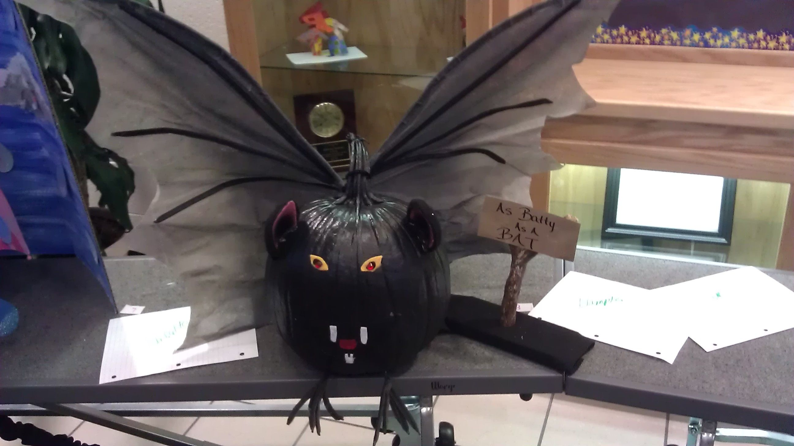 My son's class had to decorate a pumpkin as a bat and this was our creation.