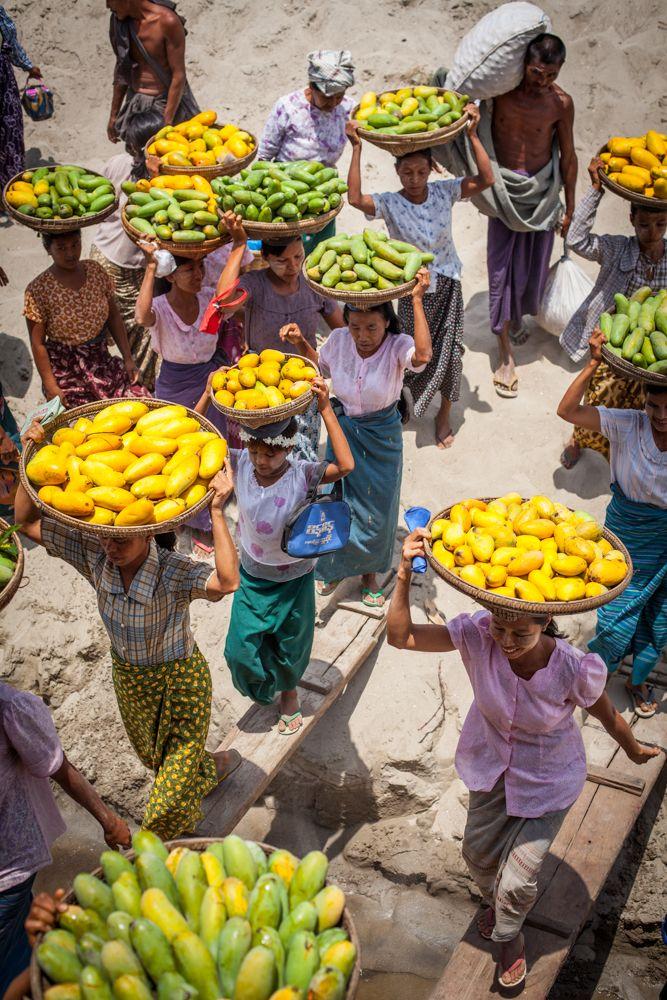Women rush aboard the ferry to sell mangoes. Irrawaddy River, Myanmar #irrawaddy, #myanmar, #burma