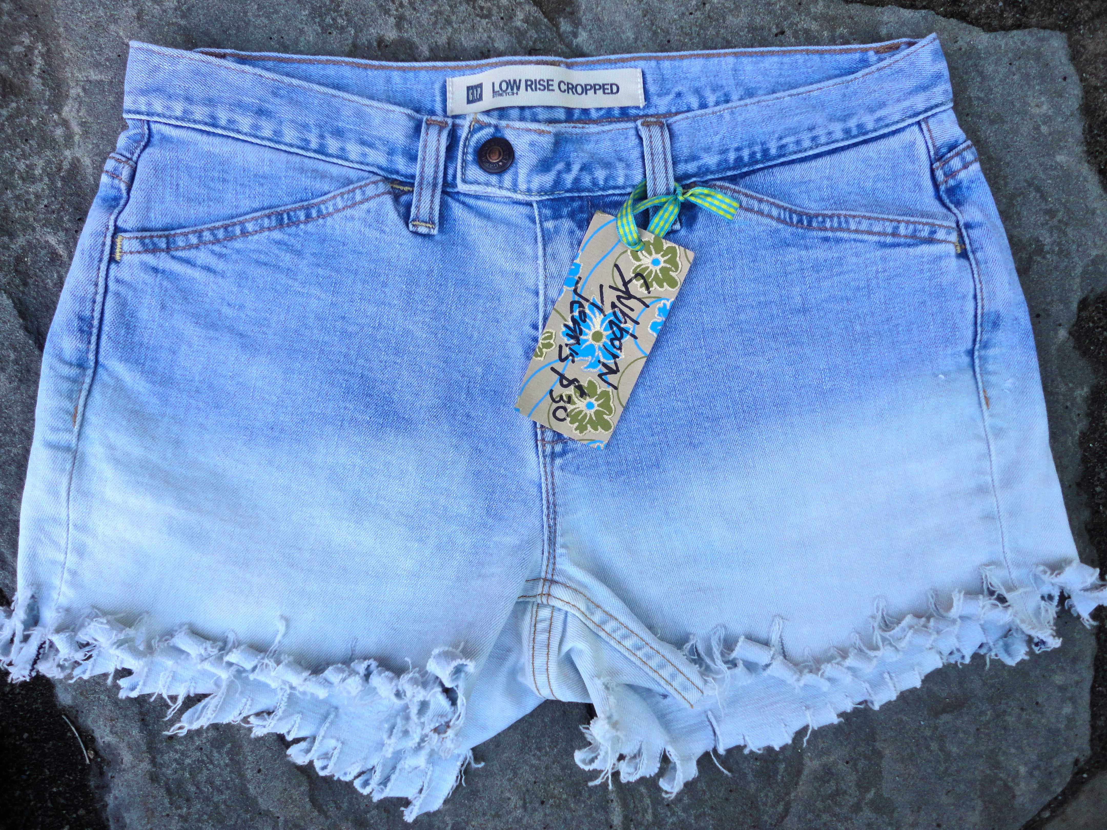 Upcycled jeans shorts by 16-year old designer Sophia Scanlan for Stubborn Jeans. Soft blue with curly bottoms.
