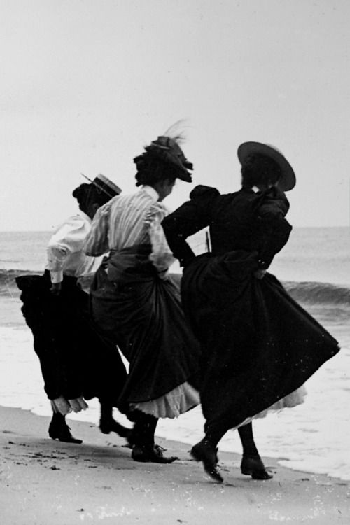vestatilleys:  Gertrude Hubbell, Ruth Peters and Mildred Grimwood, hiking their skirts at the shoreline of the beach in Arverne, Queens. By Wallace G. Levison, 1897.