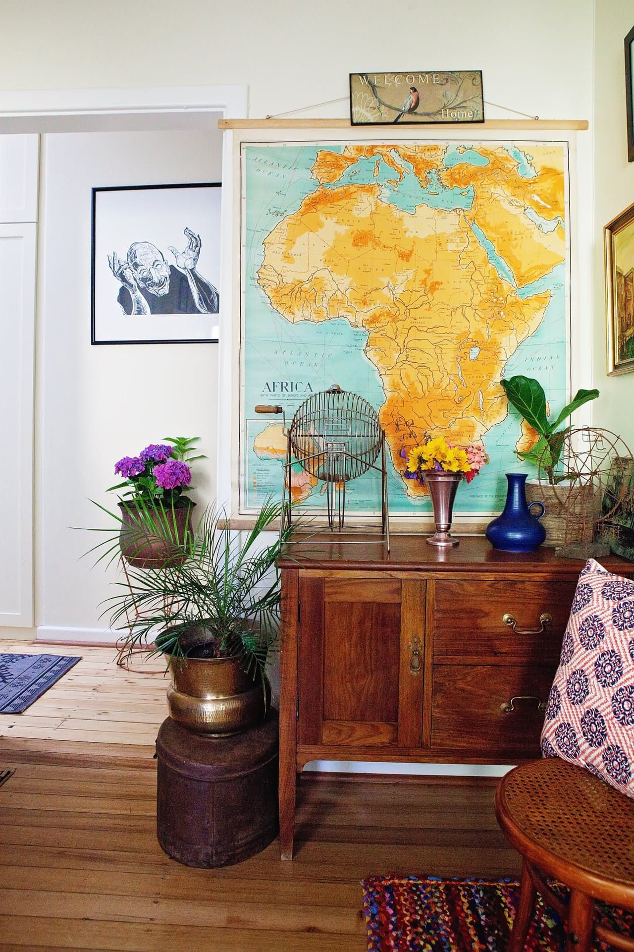 stacked, eclectic wall art helps create a bohemian vibe | the