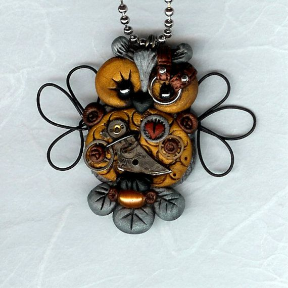 Steampunk Hooty Owl Necklace Pendant Silver And Gold Color Clay Wire Wings Polymer Clay Jewelry. $30.00, via Etsy.