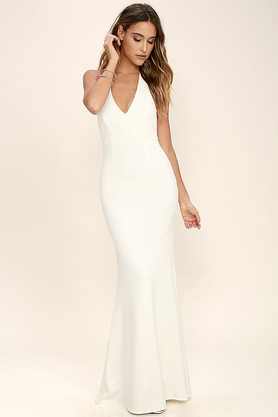 aed9adb7c2d Work your magic in the Love Potion Ivory Lace Halter Maxi Dress! A gorgeous lace  overlay shapes a plunging halter neckline with double covered button ...