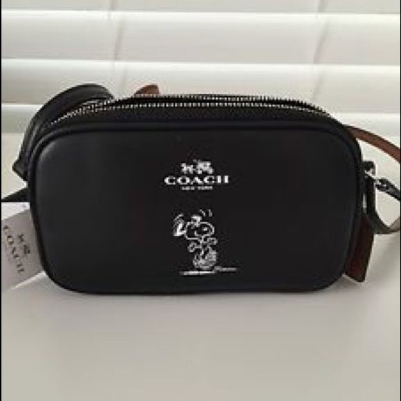 972086a26 NWT Coach Snoopy Cross Body bag! Brand new with tags and sold out in  stores! Beautiful black leather Snoopy Coach Crossbody! 22 inch adjustable  strap drop.