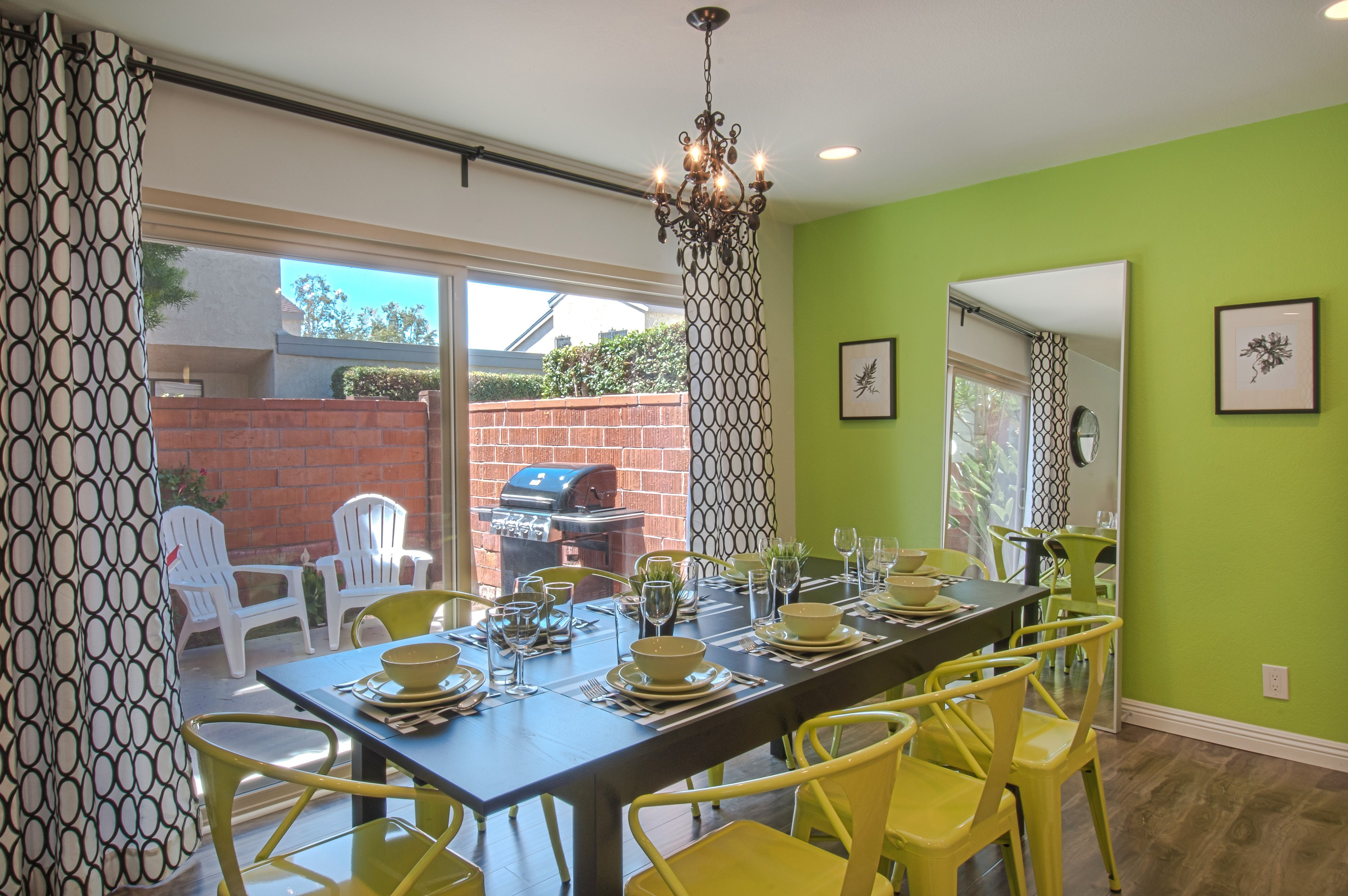 Lime green and black dining room open floor plan grey wood