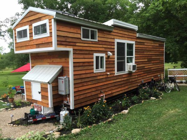 Jess and Adam's Mustard Seed Tiny House with 2 kids and a cat