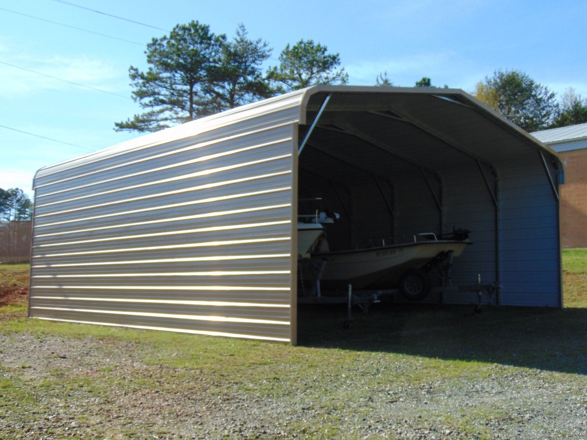 Protect Your Boats And Rvs From The Snow Sun Wind And Rain With A New Metal Enclosure Enterprise Supercenter Can Custom B Boat Covers Metal Rv Carports Boat
