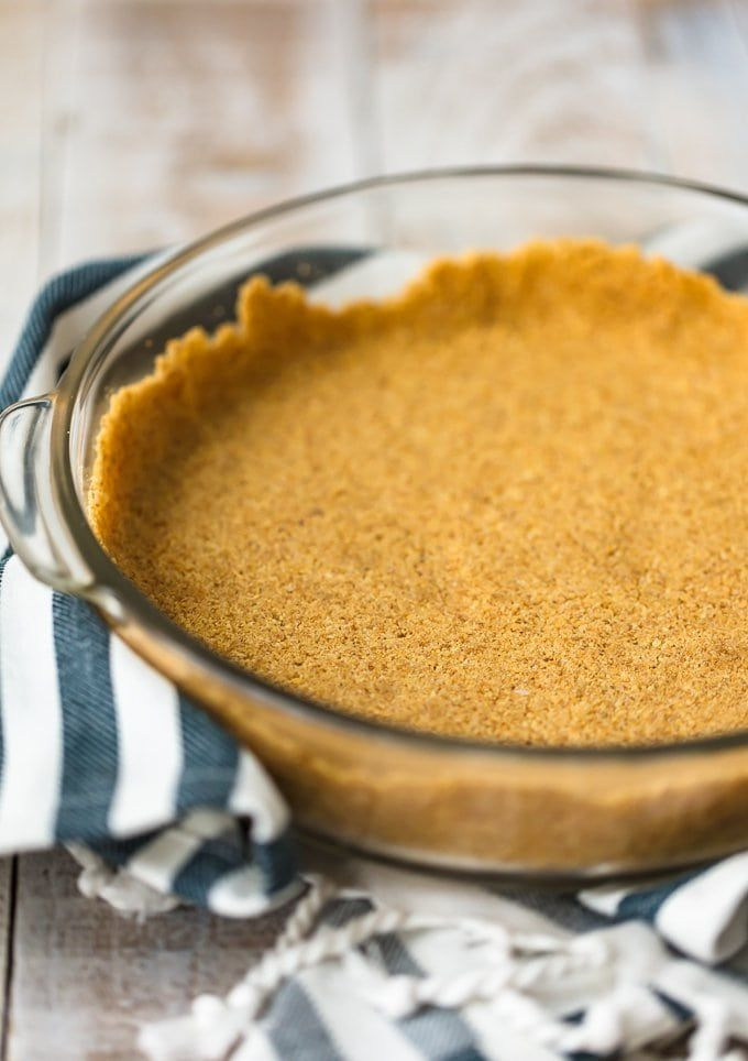 Homemade Graham Cracker Crust #homemadegrahamcrackercrust Graham Cracker Crusts add such a fun flavor and texture to cheesecakes and pies. This homemade graham cracker crust recipe is so easy to make, and doesn't require any baking. It's perfect for no bake desserts and makes for a special holiday treat! #homemadegrahamcrackercrust Homemade Graham Cracker Crust #homemadegrahamcrackercrust Graham Cracker Crusts add such a fun flavor and texture to cheesecakes and pies. This homemade graham cracke #homemadegrahamcrackercrust