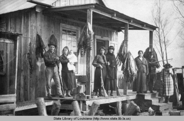 Ringtail coon pelts on the porch of trappers cabin in Louisiana in the 1930s