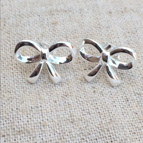 Sterling Silver 925 Bow Stud Earrings Sterling silver polished finish stud earrings feature bow designs.  Adorable and perfectly sized at 3/8 inch high x 1/2 inch wide. Jewelry Earrings