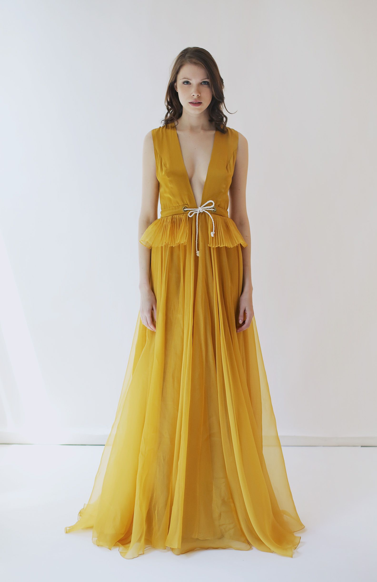 a80fb251d3f Gorgeous silk charmeuse and organza gown in a rich shade of Autumn Gold Mustard  yellow. . It has an alluring deep v-neckline and keyhole in back with a ...